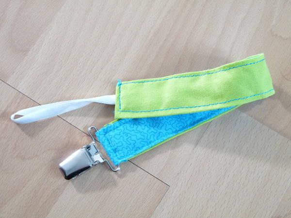 Accessoire attache tétine